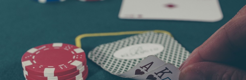 What You Should Know About a Gambling Symposium Recently Held in the US US Hand playing poker game on casino 860x280 - The Most Popular Casino Games in New Zealand