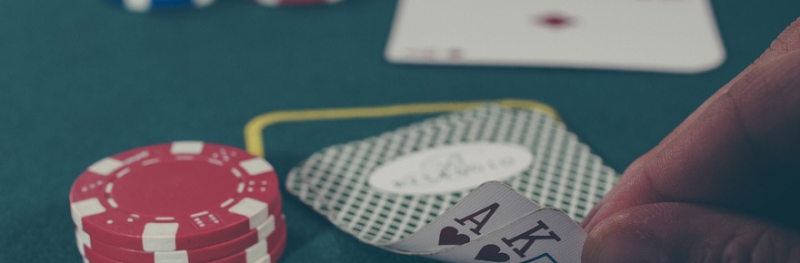 What You Should Know About a Gambling Symposium Recently Held in the US US Hand playing poker game on casino 880x290 - What You Should Know About a Gambling Symposium Recently Held in the US